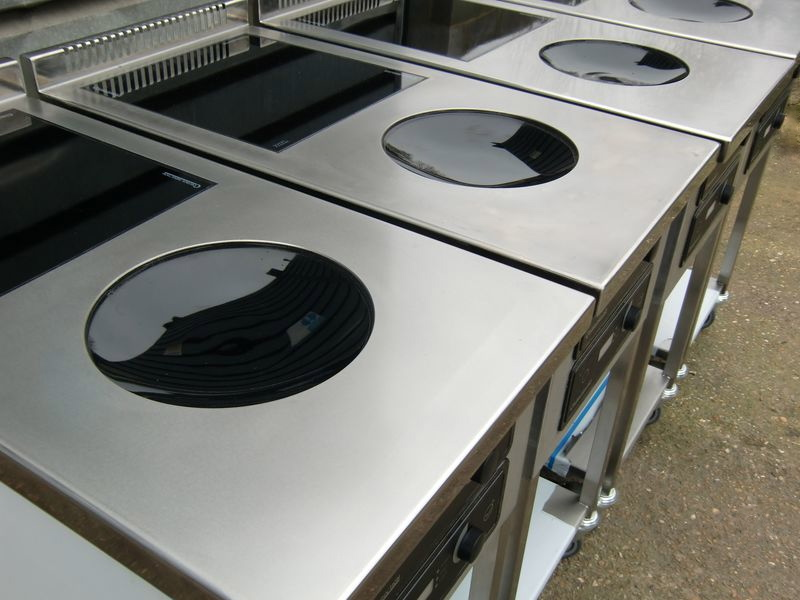 four_induction_woks_with_single_flat_hob.jpg