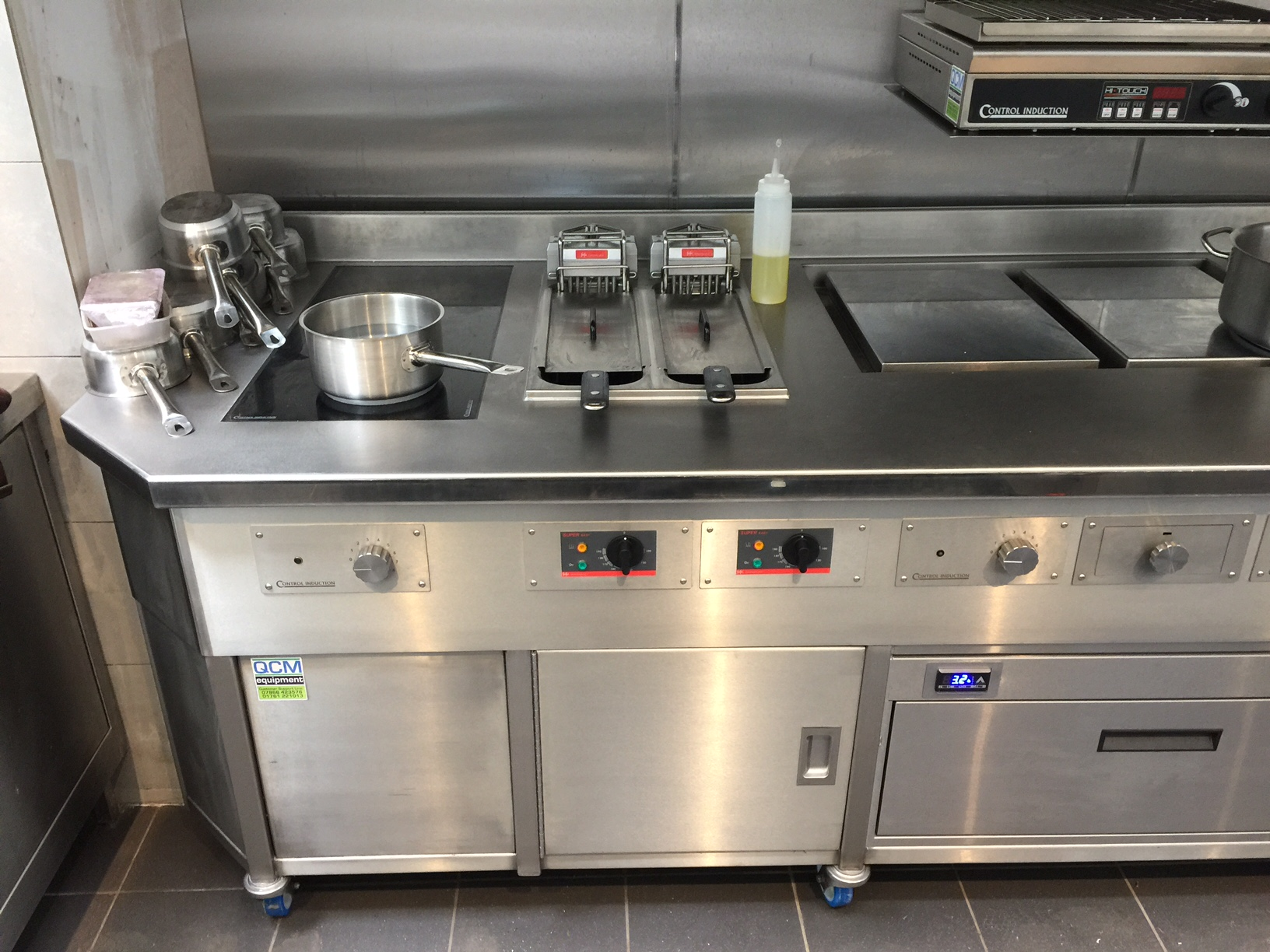 Induction wall suite with Slider fryers planchas and slamander
